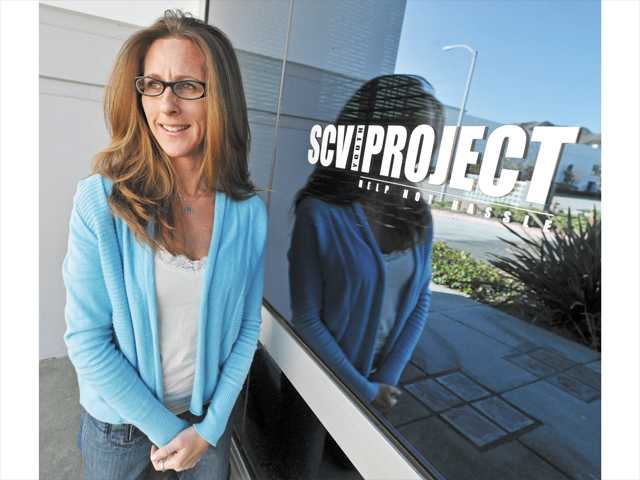In this December 2011 photo, Kim Goldman stands outside the SCV Youth Project's building in Valencia.