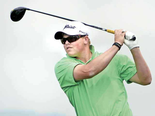 West Ranch graduate and Long Beach State golfer J.J. Holen tees off at TPC Valencia on Monday.