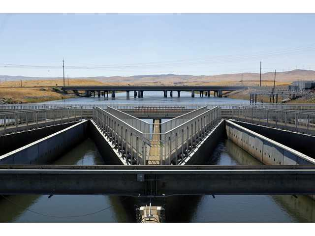 In this Sept. 23, 2013 file photo, water flows through fish diversion louvres at the John E. Skinner Delta Fish Protective Facility from the Clifton Court Forebay on its way to the Harvey O. Banks pumping plant, near Tracy.