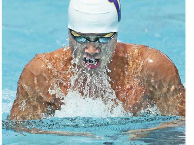 Valencia's Kevin Dai breaks swims in the 200-yard individual medley during the Foothill League prelims on Tuesday at the Santa Clarita Aquatics Center. Dai broke the Foothill League and meet record in the event.
