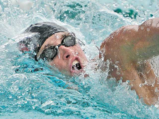 Hart's Matt Johnson starts the 200-yard freestyle on Tuesday during the Foothill League prelims at Santa Clarita Aquatics Center.