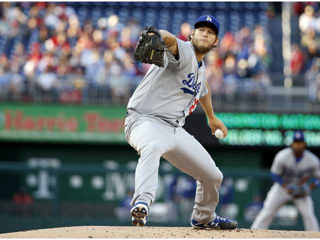 Los Angeles Dodgers starting pitcher Clayton Kershaw throws against the Washington Nationals on Tuesday in Washington.