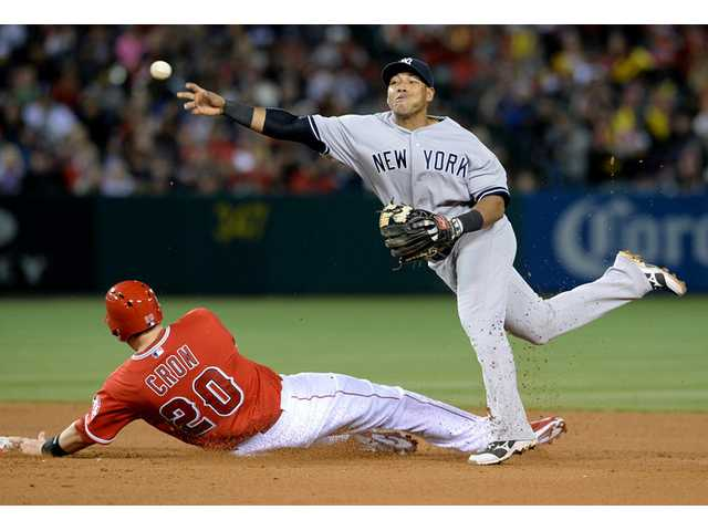 Los Angeles Angels' C.J. Cron is out at second base as New York Yankees' Yangervis Solarte completes the double play in Anaheim on Tuesday.