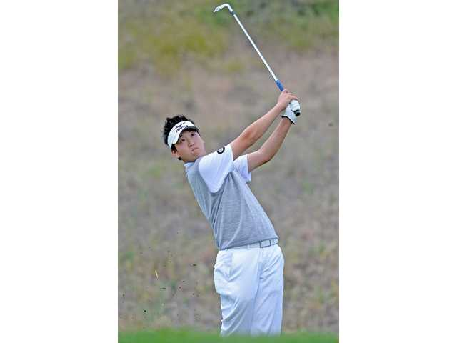 Golden Valley's Jonathan Kang hits a tee shot on the 11th hole at TPC Valencia on Wednesday.