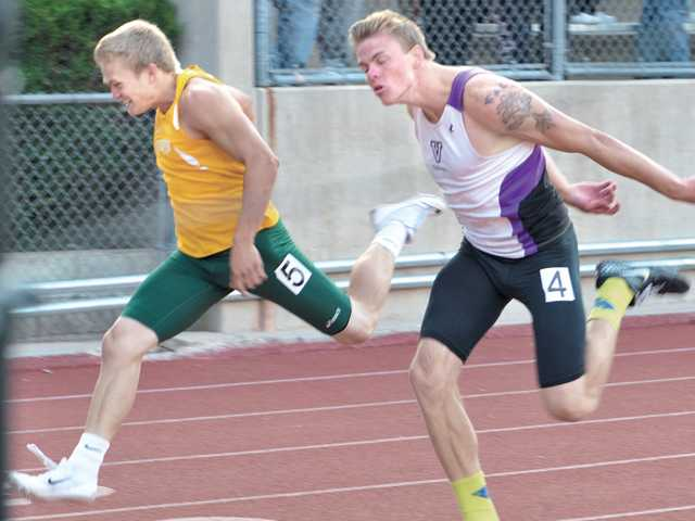 Canyon's Cole Mears, left, leans forward at the wire to win the 200-meter dash against Valencia's Nick Jones on Thursday at College of the Canyons.