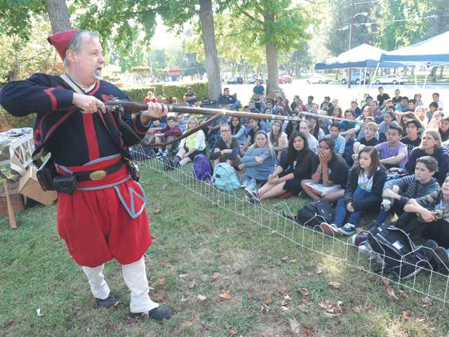 Ralph Keyes, dressed in the flashy uniform of a Zouave private, shows the blade of the bayonet on his musket while describing bayonet warfare during warfare between Civil War soldiers. Keyes spoke during a Civil War re-enactment at Placerita Junior High School on Friday. Signal photo by Dan Watson