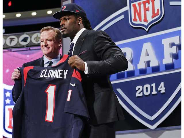 South Carolina defensive end Jadeveon Clowney holds up the jersey for the Houston Texans first pick of the 2014 NFL Draft on Thursday in New York.