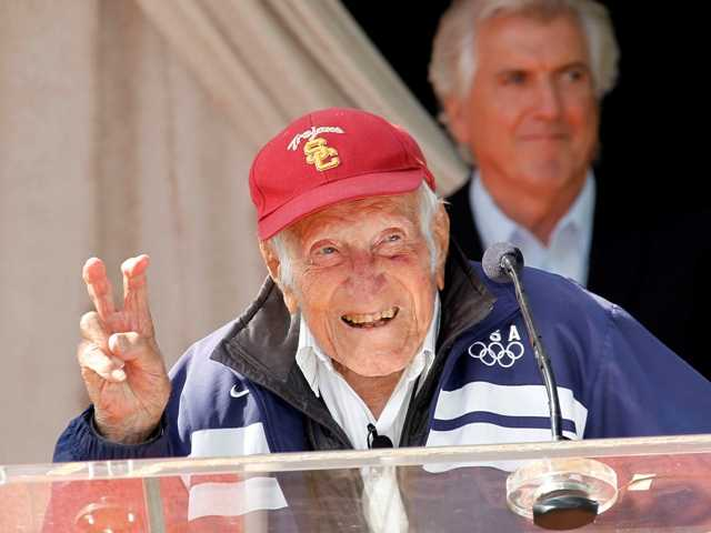 Ninety-seven-year-old World War II hero and former Olympian, Louis Zamperini has been named grand marshal of the 2015 Rose Parade.