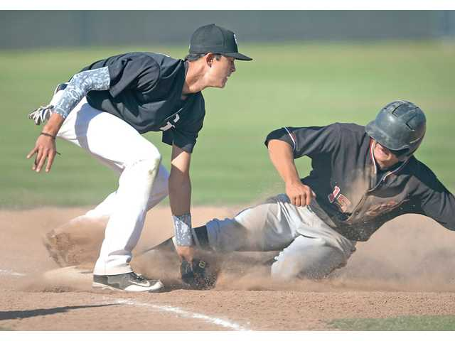 Hart's Dayton Provost, right, beats the tag by Golden Valley's Cole Bygum on Friday at Golden Valley High.