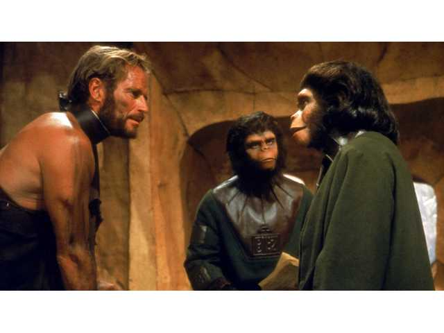 "Astronaut Charlton Heston tries to reason with his captors in the original ""Planet of the Apes"" (1968), which is rated G."