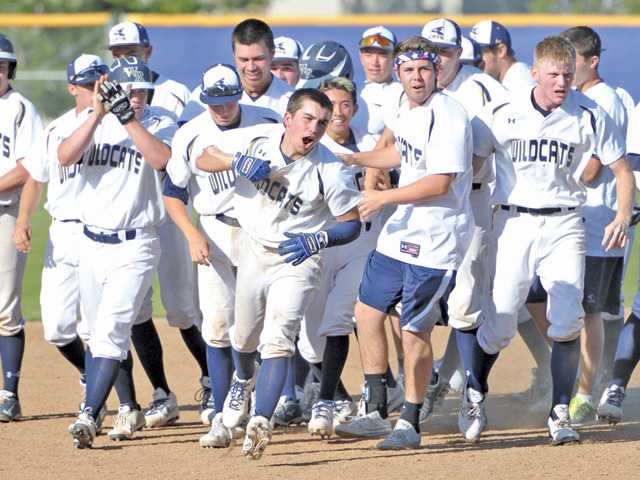 West Ranch's Jason Drees, center, celebrates with his teammates after he hit a game-winning single to beat Saugus at West Ranch High School on Friday.