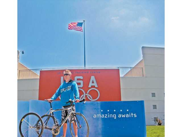 A former member of the U.S. Paralympic Cycling Team, Baker stands outside the U.S. Olympic Training Center.