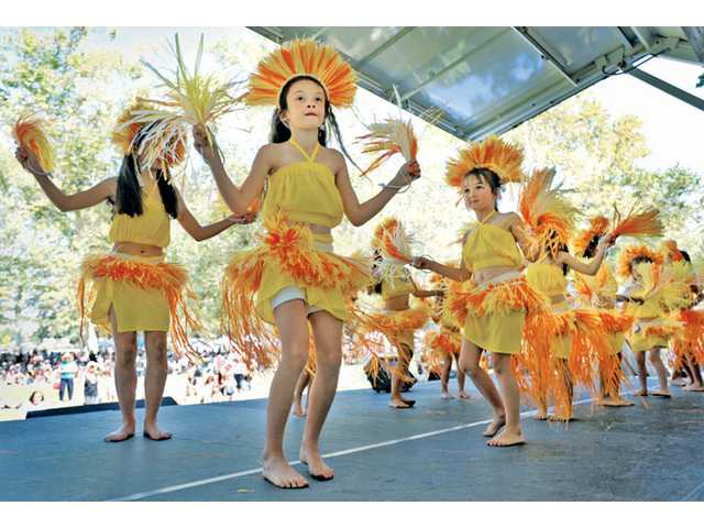 Simantha Spaulding, 7, dances on stage at the first Santa Clarita Pacific Islander Festival at William S. Hart Park in Newhall on Saturday.