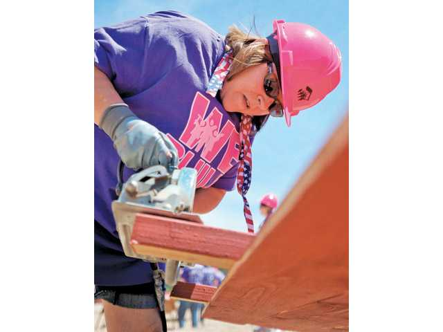 Patty Leone saws the end of a fence at the Women Empowerment Build event for Habitat for Humanity of the San Fernando and Santa Clarita Valleys on May 10.