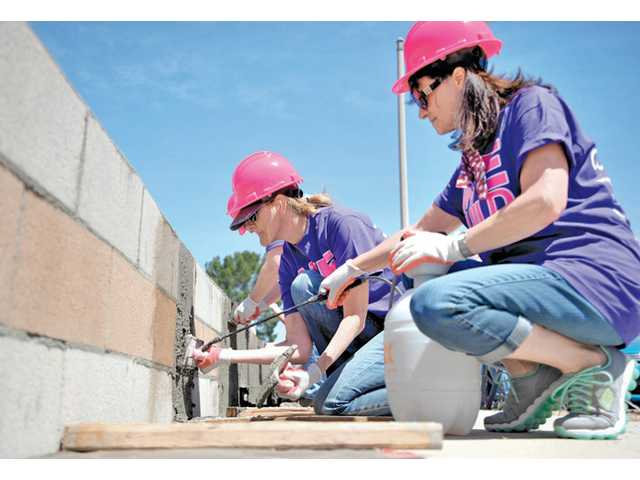 Nancy Shauer, right, and Kathryn Moseley cement a retaining wall at the Women Empowerment Build event for Habitat for Humanity of the San Fernando and Santa Clarita Valleys on May 10.
