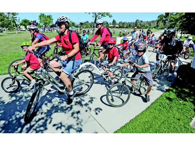 A group of riders from Cub Scout Pack 527 of Valencia join more than 100 bike riders at the start of the Hit The Trail Community Bike Ride event held at Bridgeport Park in Valencia to celebrate Bike Safety Month on Saturday. The event also readies residents for the upcoming Amgen Tour of California, coming to the SCV from May 16-17.