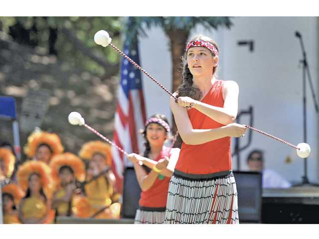 Rachel Pickler dances a traditional Maori dance with the Kalakeke Pacific Island Dance Company at the first Santa Clarita Pacific Islander Festival held at William S. Hart Park on Saturday.