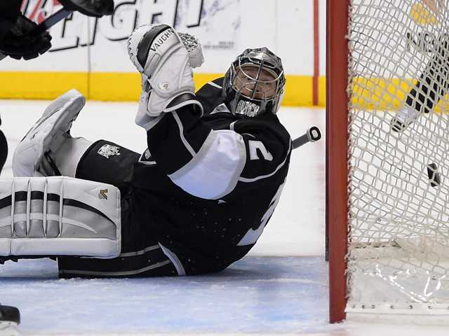 Los Angeles Kings goalie Jonathan Quick is scored on by Anaheim Ducks right wing Devante Smith-Pelly during the first period of Saturday's Game 4 in Los Angeles.