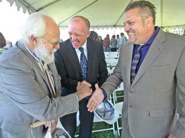 Dignitaries, from left, Acton-Agua Dulce Unified School District school board member Harry Layton, Superintendent Brent Woodard and Vasquez High School Principal Ty Devoe celebrate after the school groundbreaking Monday in Acton. Signal photo by Dan Watson