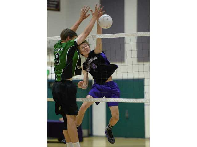 Valencia's Dakota Abbott (18) hits the ball past Thousand Oak's Chad Esseff on Tuesday at Valencia High School. Photo by Jayne Kamin-Oncea