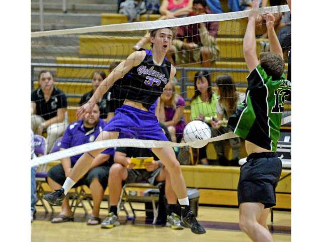 Valencia's Trevor Nally (37) hits the ball past Thousand Oaks defender Reed Loose (13) on Tuesday at Valencia High School. Photo by Jayne Kamin-Oncea