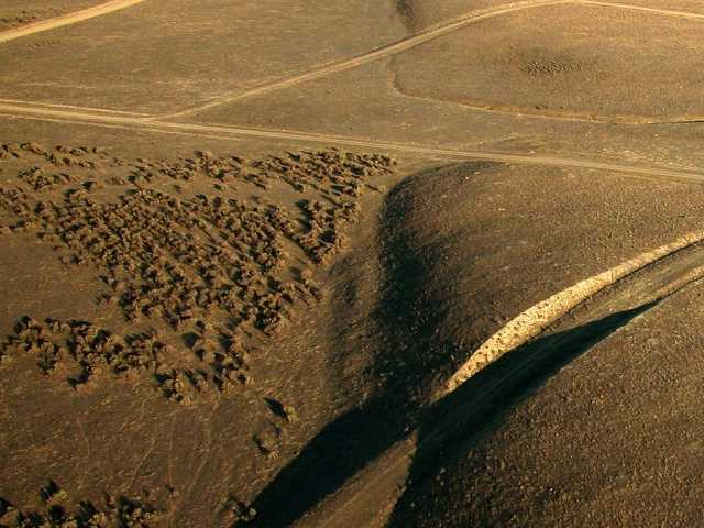 A 2007 photo along the surface trace of the San Andreas fault in California. Excessive groundwater pumping for agricultural irrigation can potnetially create future earthquakes.