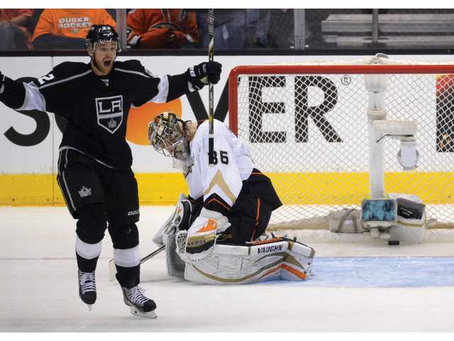 Los Angeles Kings center Trevor Lewis, left, celebrates his goal as Anaheim Ducks goalie John Gibson reacts during the second period of Wednesday's Game 6 in Los Angeles.
