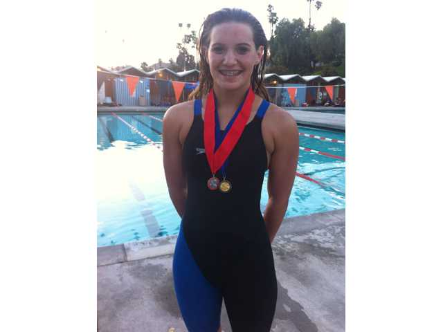Santa Clarita Christian freshman Victoria Kirshner stands with her gold and silver medals after Friday's CIF-Southern Section Division IV championships at Riverside City College. Photo courtesy of SCCS