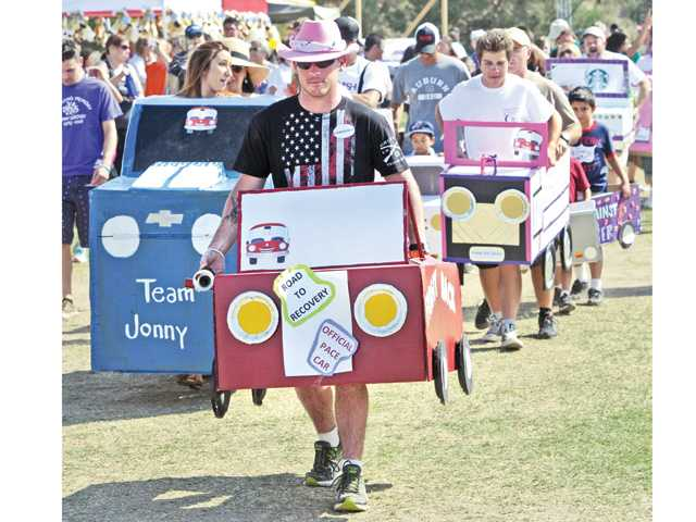 Justin Peris is the pace car that leads a group of handmade cardboard cars in a parade at the Relay of Life event held at Central Park. The annual event raises money and awarenes for cancer research.