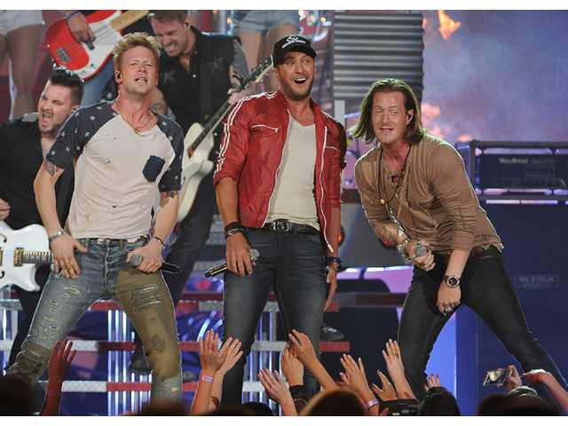 Luke Bryan, center, and from left, Brian Kelley and Tyler Hubbard, of the musical group Florida Georgia Line, perform at the Billboard Music Awards at the MGM Grand Garden Arena on Sunday in Las Vegas.