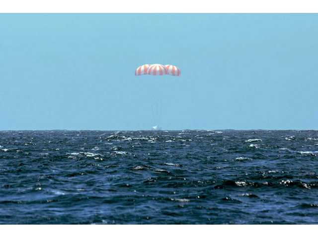 This photo provided by SpaceX shows SpaceX's Dragon spacecraft splashing down into the Pacific Ocean on Sunday after it successfully completed the CRS 3 mission for NASA.