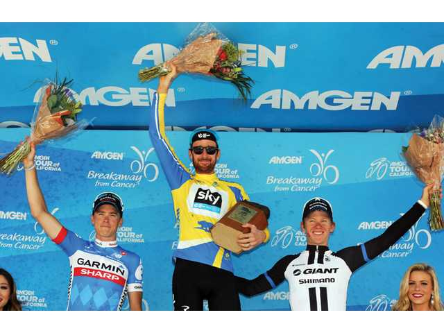 Bradley Wiggins, center, stands on stage after becoming the overall winner of the Tour of California cycling race on Sunday in Thousand Oaks.