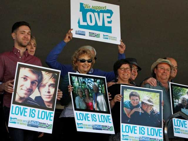 A federal judge will hear arguments Wednesday about whether a national group can defend Oregon's ban on same-sex marriage. Above, supporters of same-sex marriage in Eugene, Ore.