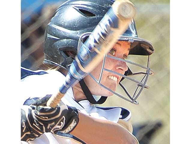 West Ranch's Mollie Sorenson (22) hits a triple in the against Pacifica of Oxnard at West Ranch on Tuesday.
