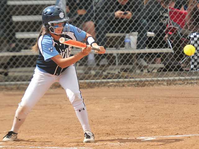 Saugus High's Ryleigh Bermea bunts during a CIF-SS Division I playoff game against Canyon of Anaheim at Saugus High School on Tuesday.