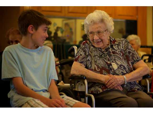 (Left) Jackson Cayson sits with (right) Margaret McGreevy, 100, at her birthday bash on Friday.
