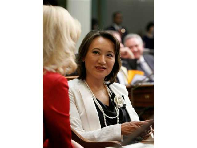 In this Jan. 4, 2012 file photo, former Assemblywoman Mary Hayashi, D-Hayward, right, talks with then Assemblywoman Cathleen Galgiani, D-Ceres, at the Capitol in Sacramento, Calif.