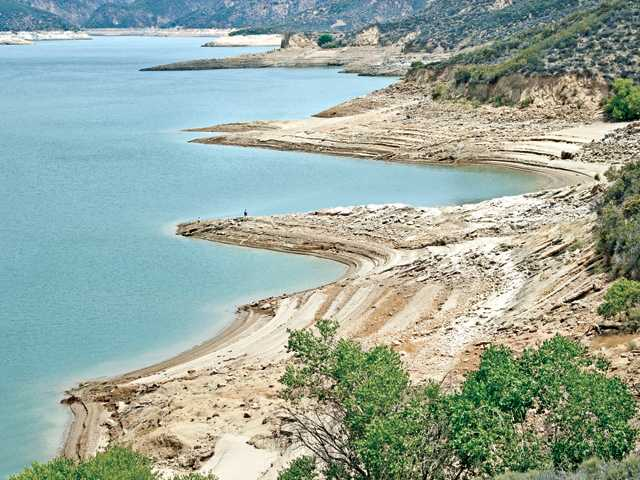 Long, sandy beaches mark the low level water line of Castaic Lake on Wednesday. Signal photo by Dan Watson.