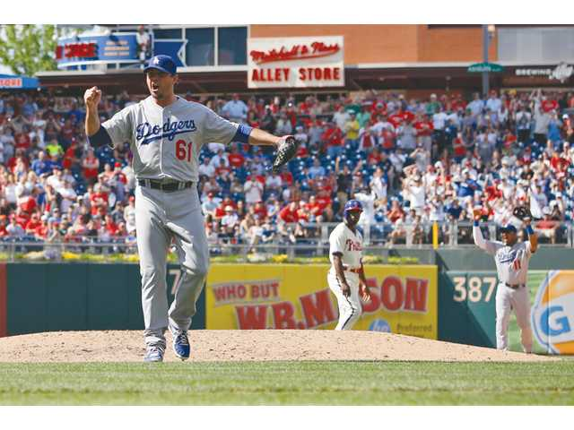 Los Angeles Dodgers starting pitcher Josh Beckett reacts after striking out Philadelphia Phillies' Chase Utley on Sunday in Philadelphia.
