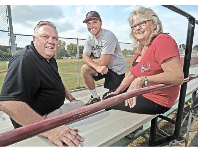 Jeff Valaika, left, and his son Nick, center, and wife Ilona are part of a family that has been heavily involved with the Hart High baseball program for several years.