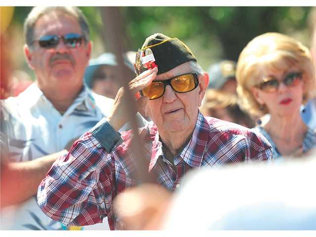World War II veteran Walter E. Anderson salutes the color guard during the Memorial Day Tribute. Signal photo by Katharine Lotze.