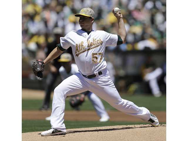 Oakland Athletics pitcher and Saugus graduate Tommy Milone works against the Detroit Tigers on Monday in Oakland.