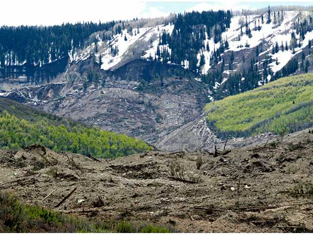 The results of a three-mile long mudslide are piled below Grand Mesa in a remote part of western Colorado on Monday.