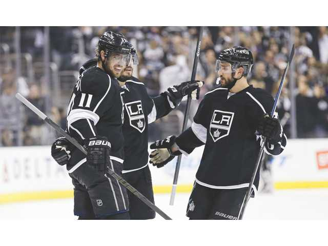 Los Angeles Kings players celebrate a goal against the Chicago Blackhawks during Game 4 of the Western Conference finals on Monday in Los Angeles.