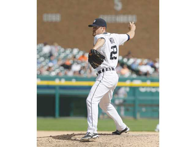 Detroit Tigers infielder and former Valencia Viking Danny Worth throws during the ninth inning of a game against the Texas Rangers in Detroit on Thursday.