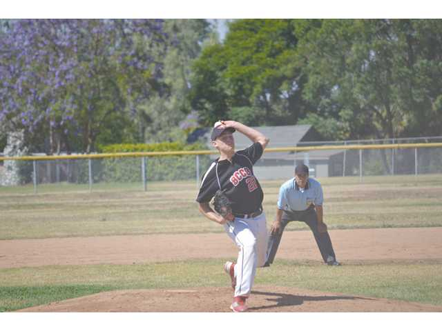 Santa Clarita Christian Clint Ross delivers to Riverside Christian on Tuesday at Riverside Christian High.