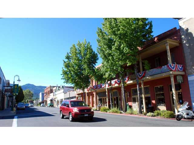 In this Sept. 6, 2013 photo, a car is driven down Miner Street past the historic Franco American Hotel in Yreka.