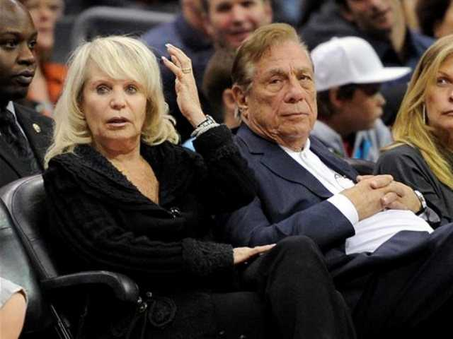 In this Nov. 12, 2010, file photo, Shelly Sterling sits with her husband, Donald Sterling, right, during the Los Angeles Clippers' NBA basketball game against the Detroit Pistons in Los Angeles.