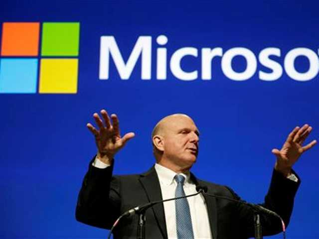 This file photo taken Nov. 19, 2013, shows then Microsoft CEO Steve Ballmer during the company's annual shareholders meeting in Bellevue, Wash.
