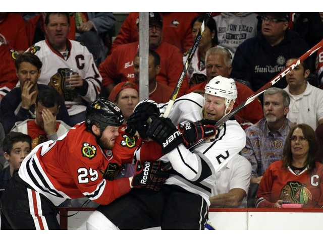 Chicago Blackhawks' Bryan Bickell (29) checks Los Angeles Kings defenseman Matt Greene (2) during Game 5 of the Western Conference finals on Wednesday in Chicago.